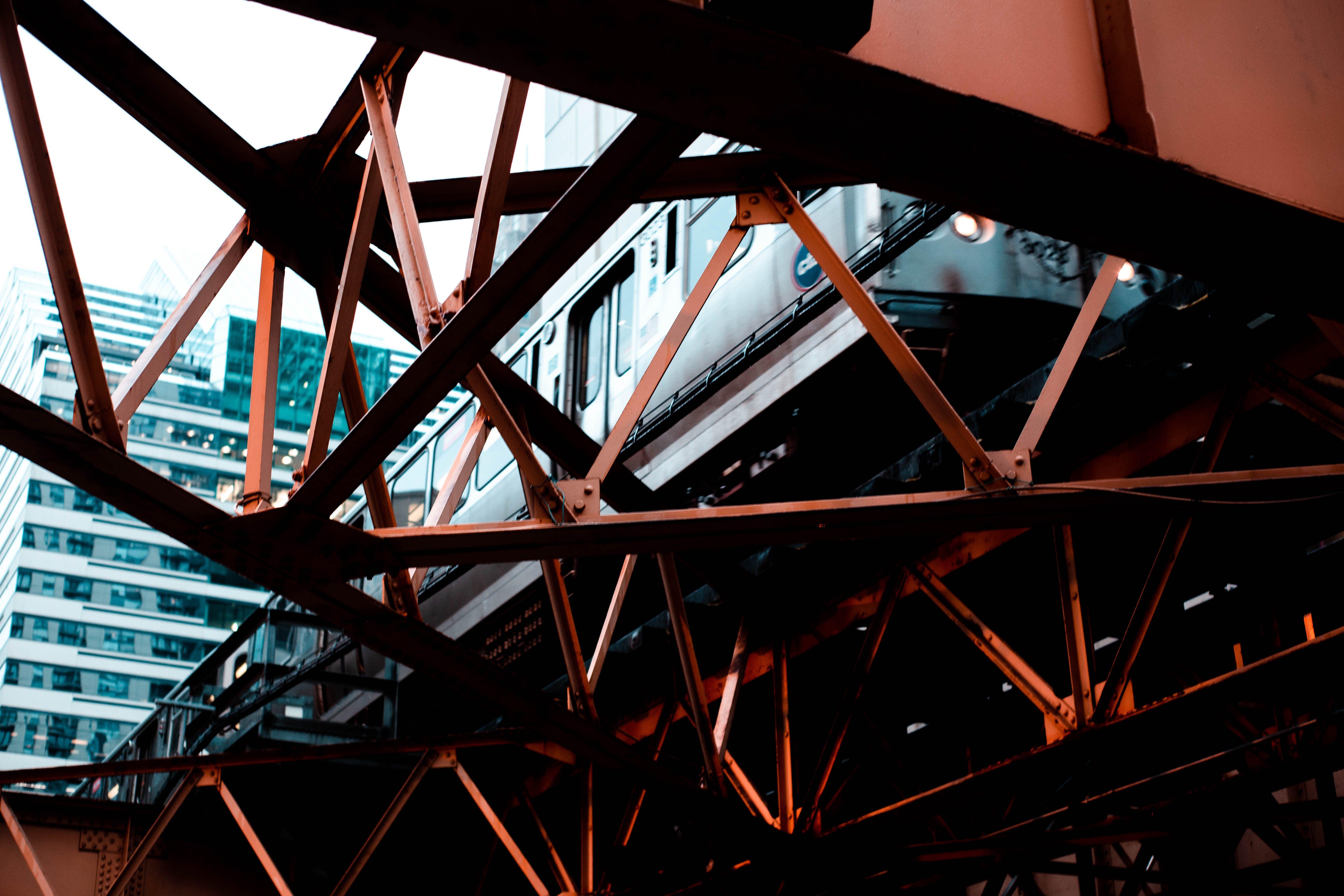 Low Angle Photo of Train on a Metal Bridge Beam