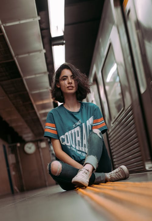 Woman Sitting on Subway Station