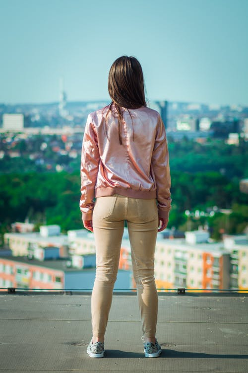 Woman Standing While Wearing Pink Jacket