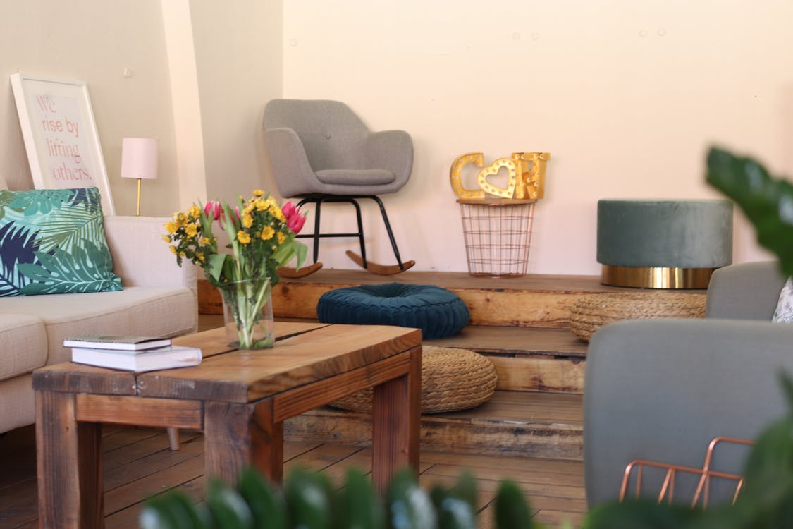 Flower Vase on Brown Wooden Coffee Table