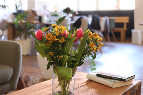 Free stock photo of books, coffee table, flowers, meeting