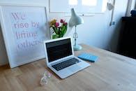 Macbook Air on Brown Table