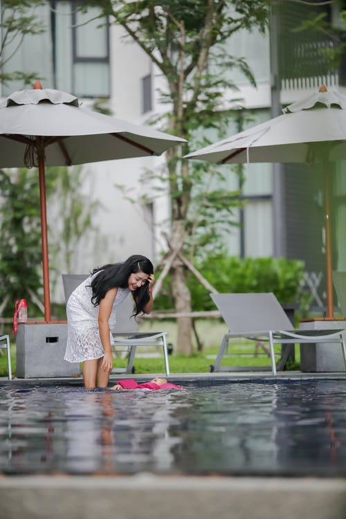 Woman Stepping on Pool