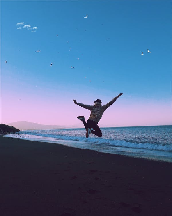 Man Jumping during Sunset on a Beach