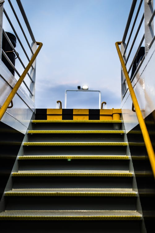 Photo of Empty Black and Yellow Metal Staircase