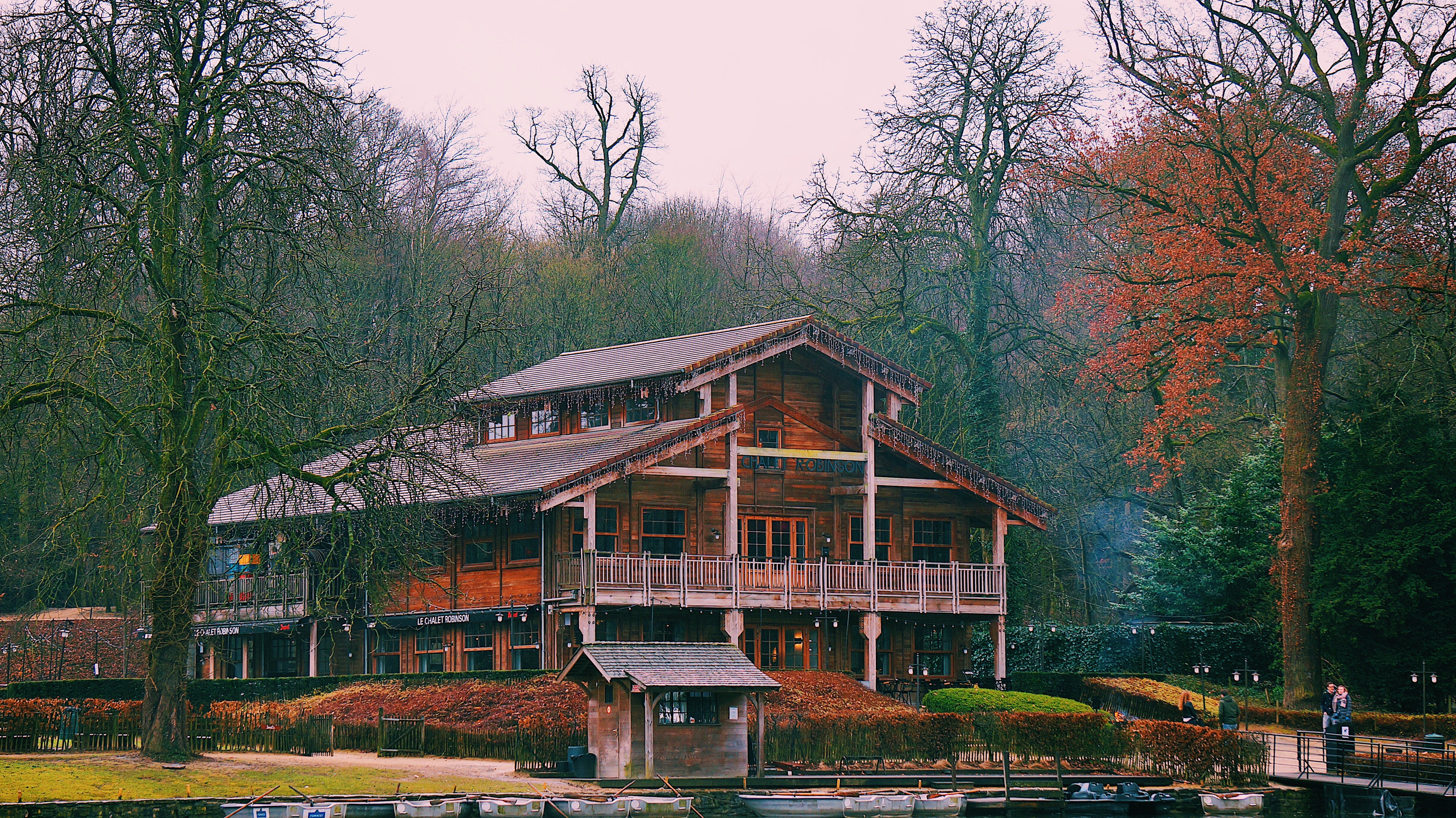 Brown Wooden Multi-story House Surrounded by Trees