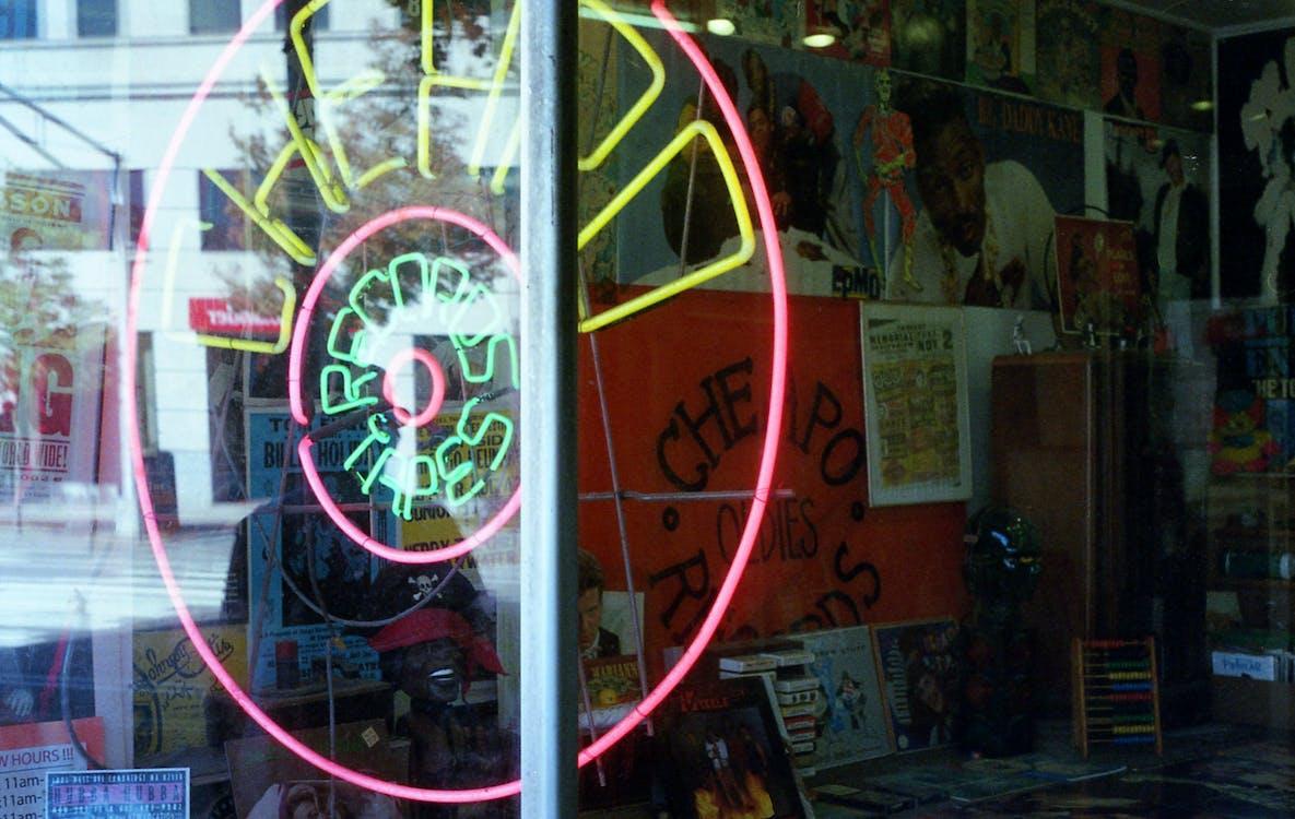 Neon Signage Turned-on Glass Window