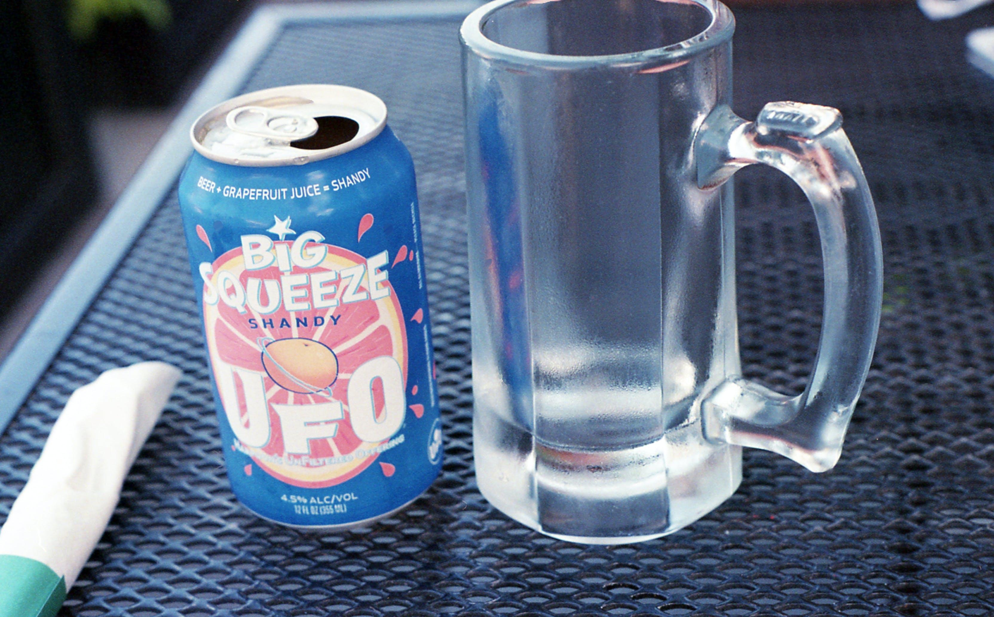 Photo of Mug Near Drink Can
