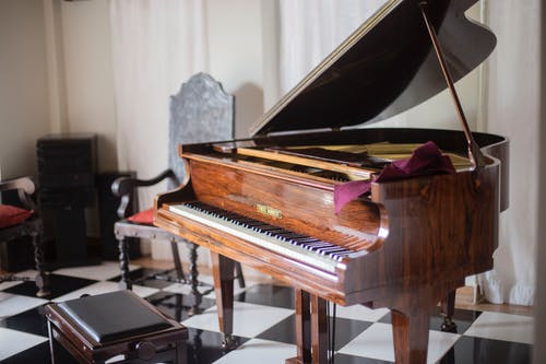 Brown Grand Piano With Chair