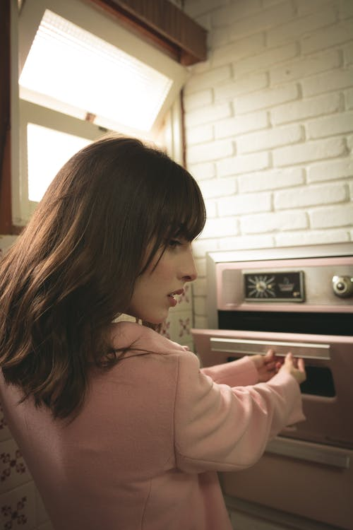 Woman Opening Oven