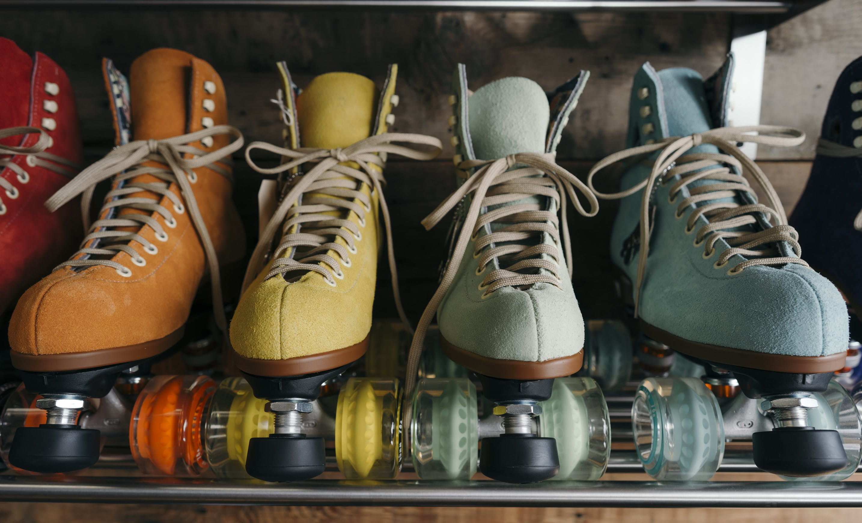 Four Unpaired Assorted Color Roller Skates