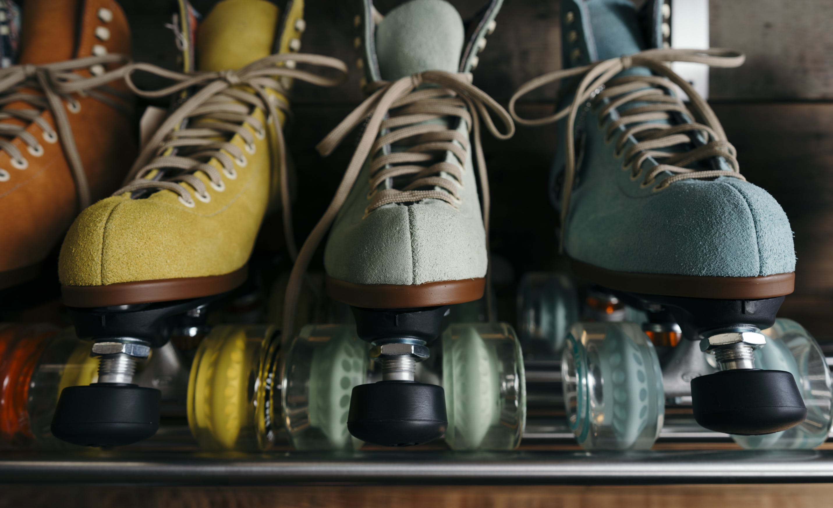 Unpaired Four Assorted-colored Leather Roller Blades