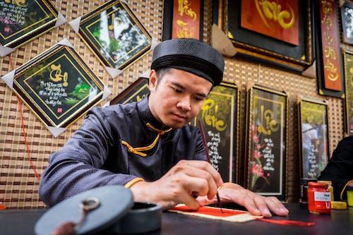 亞洲男性, 人, 寫作, 文化 的 免费素材照片