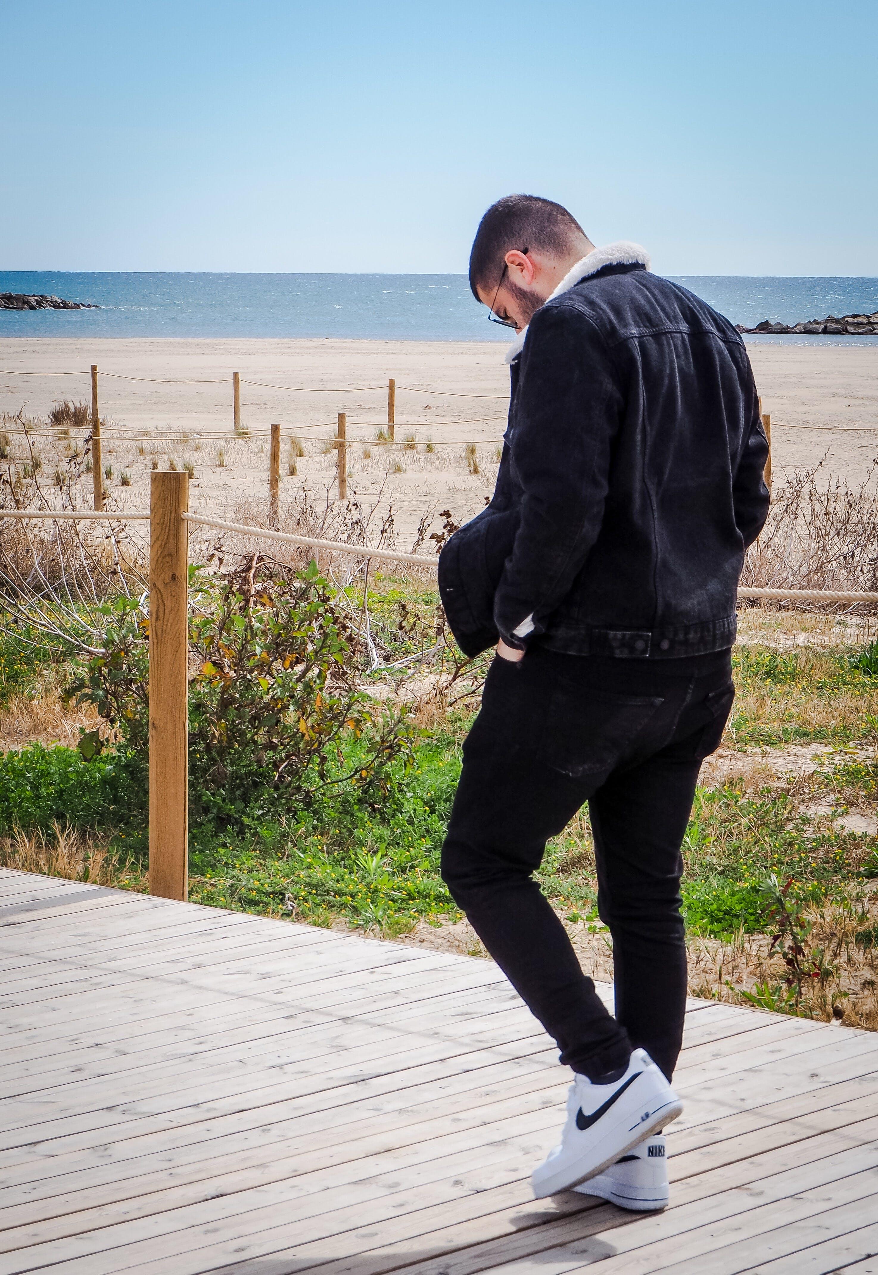 Free stock photo of beach, black, black hair, denim jacket