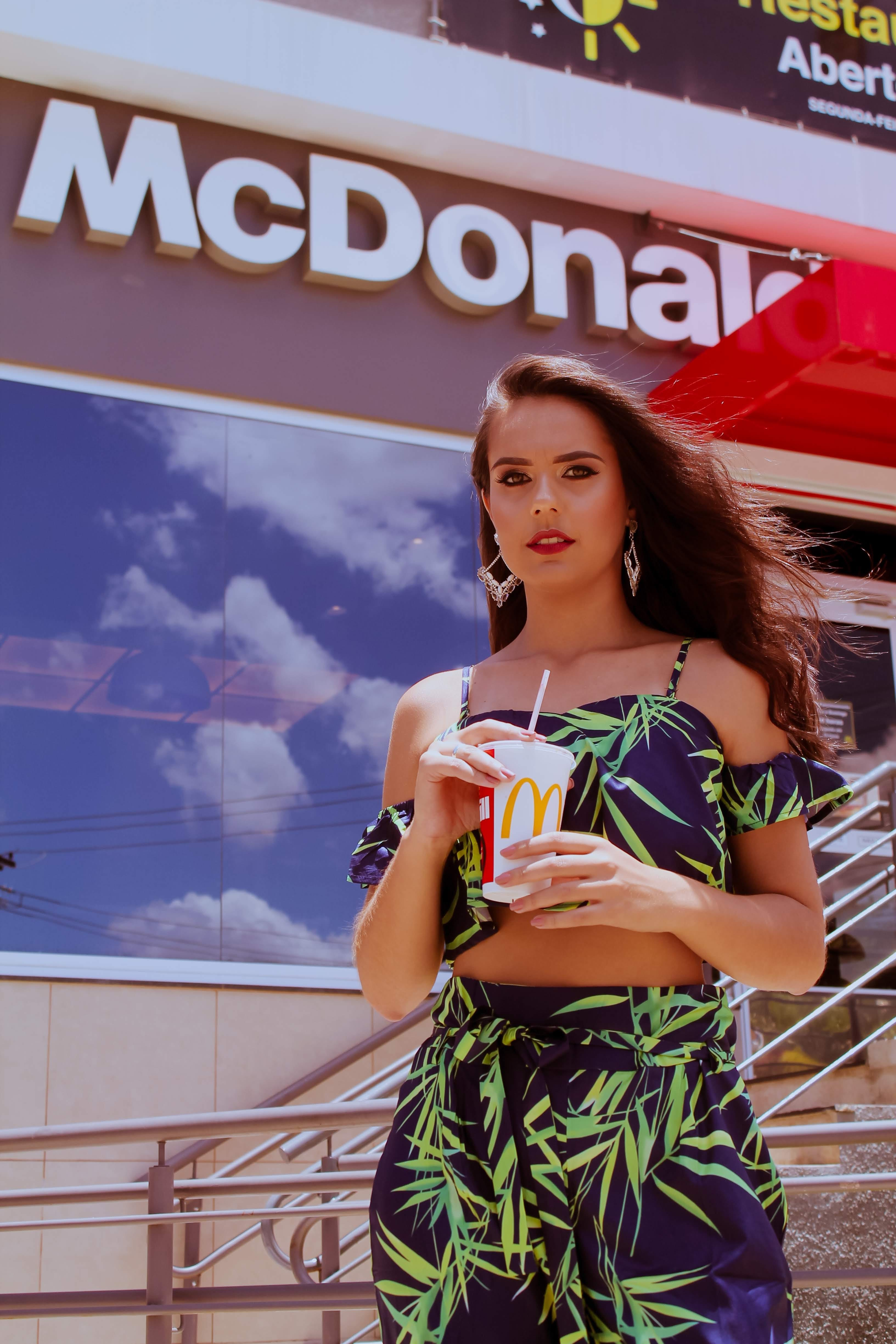Photo of Woman Holding Mcdonald's Plastic Cup