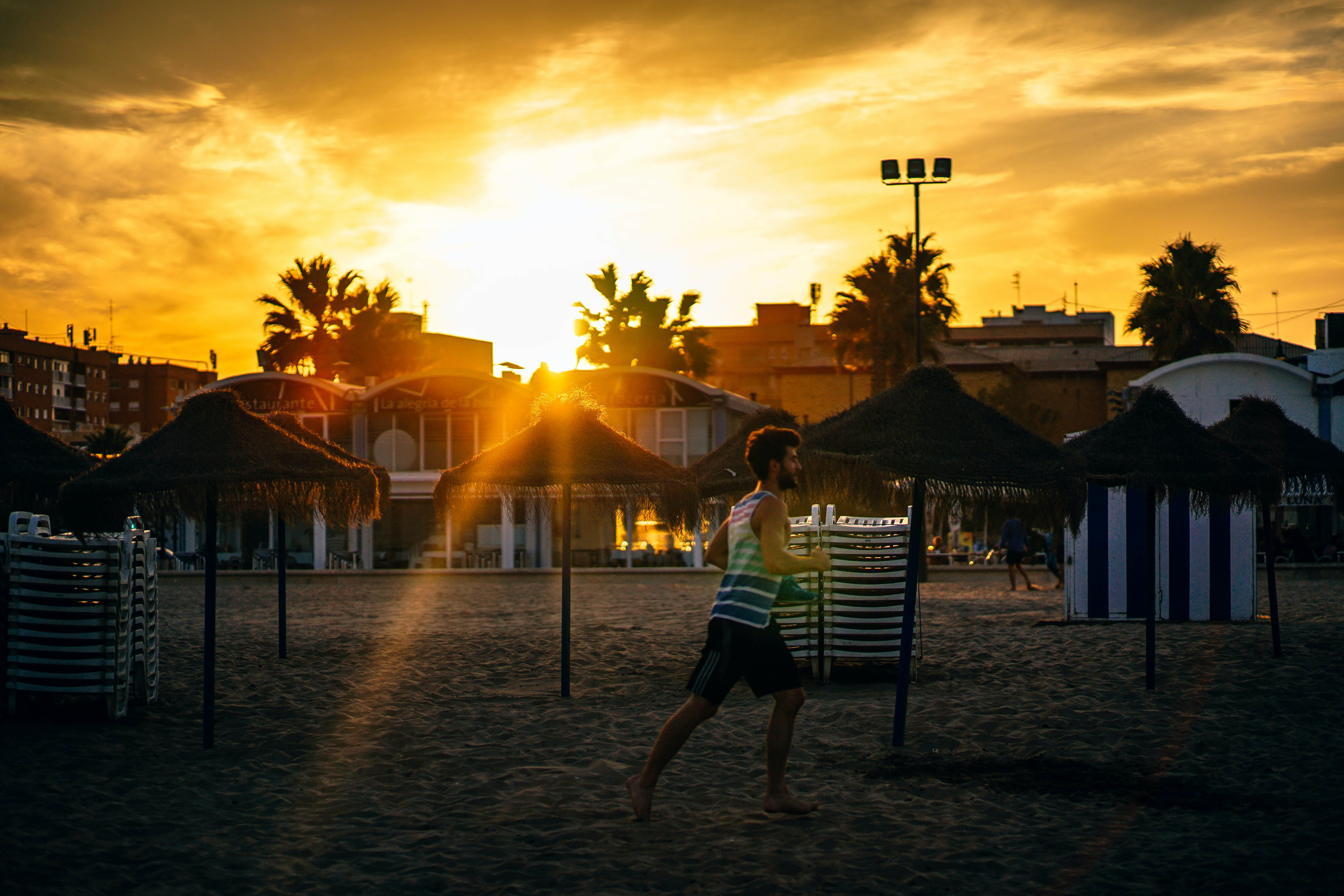 Man Running in the Beach during Sunset