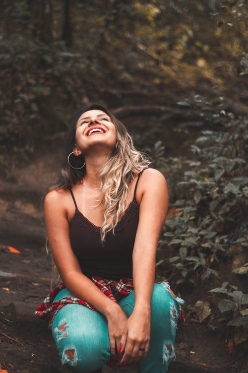 Photo of Woman Looking Up While Laughing