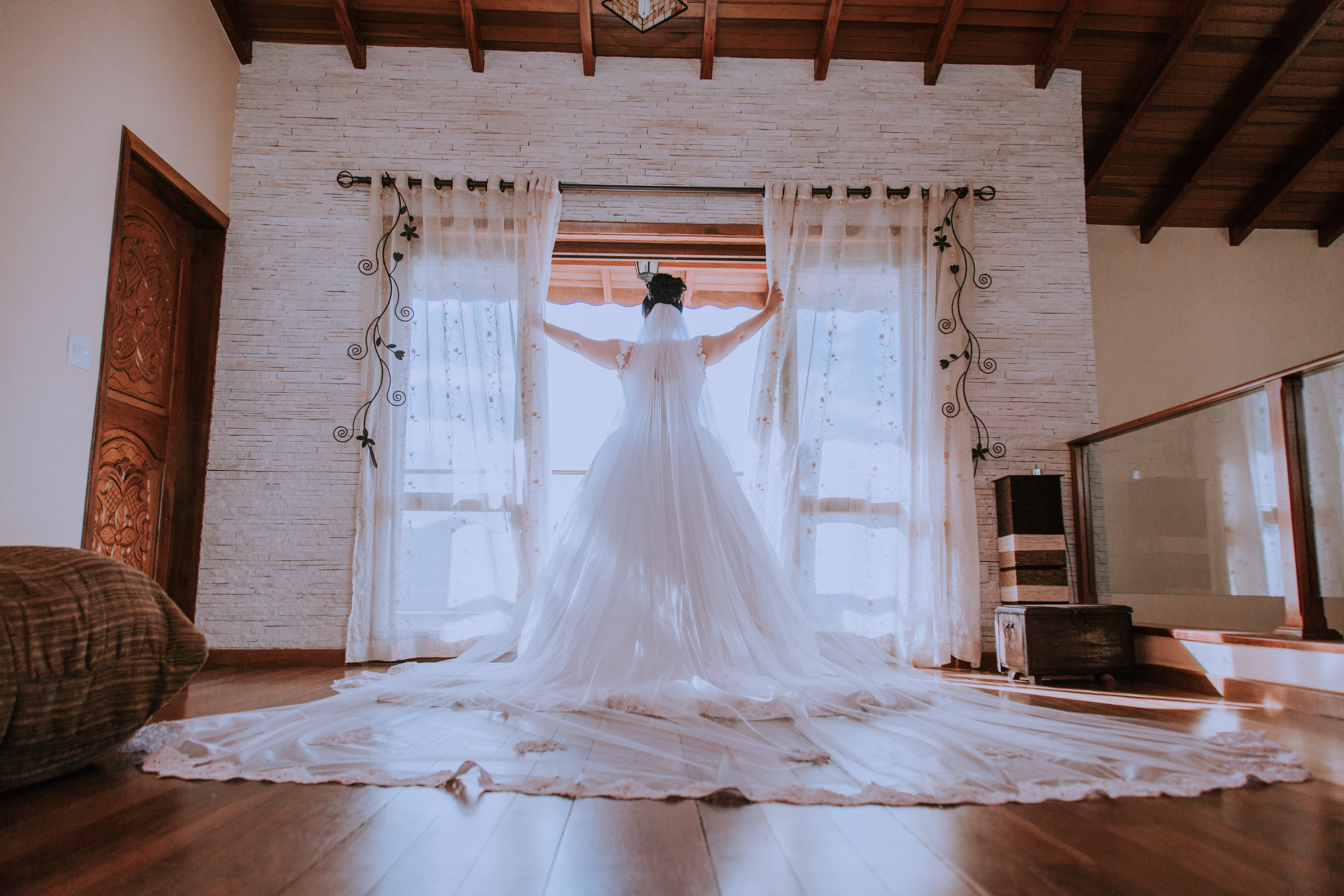 Woman in White Wedding Gown by the Window