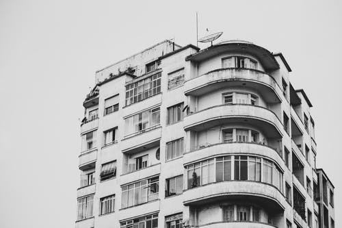 Satellite Dish on Grey Building Rooftop