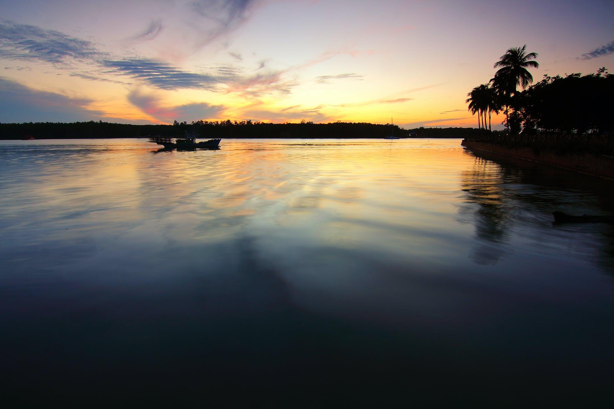 Безкоштовне стокове фото на тему «берег моря, відображення, вечір, водій»