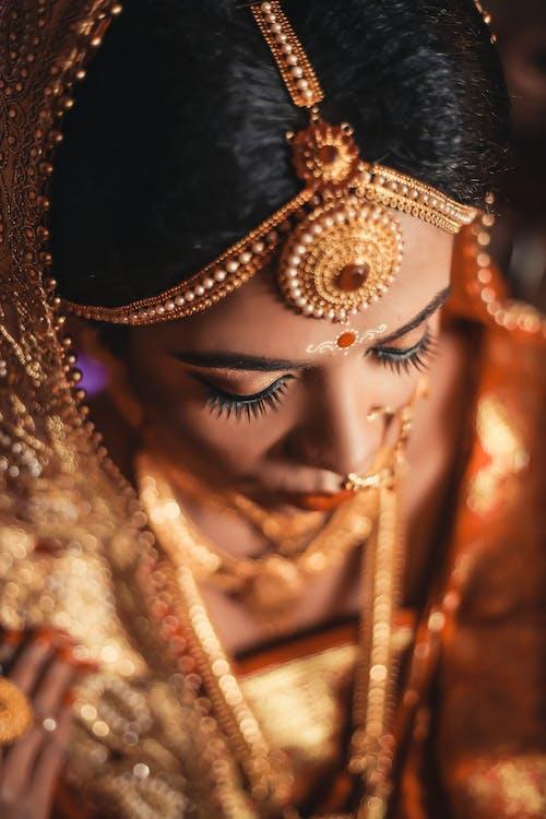 Woman Wearing Gold Dress