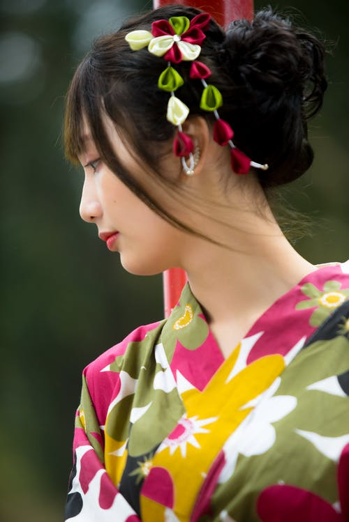 Close-up Photo of Asian Woman in Floral Kimono Looking Away