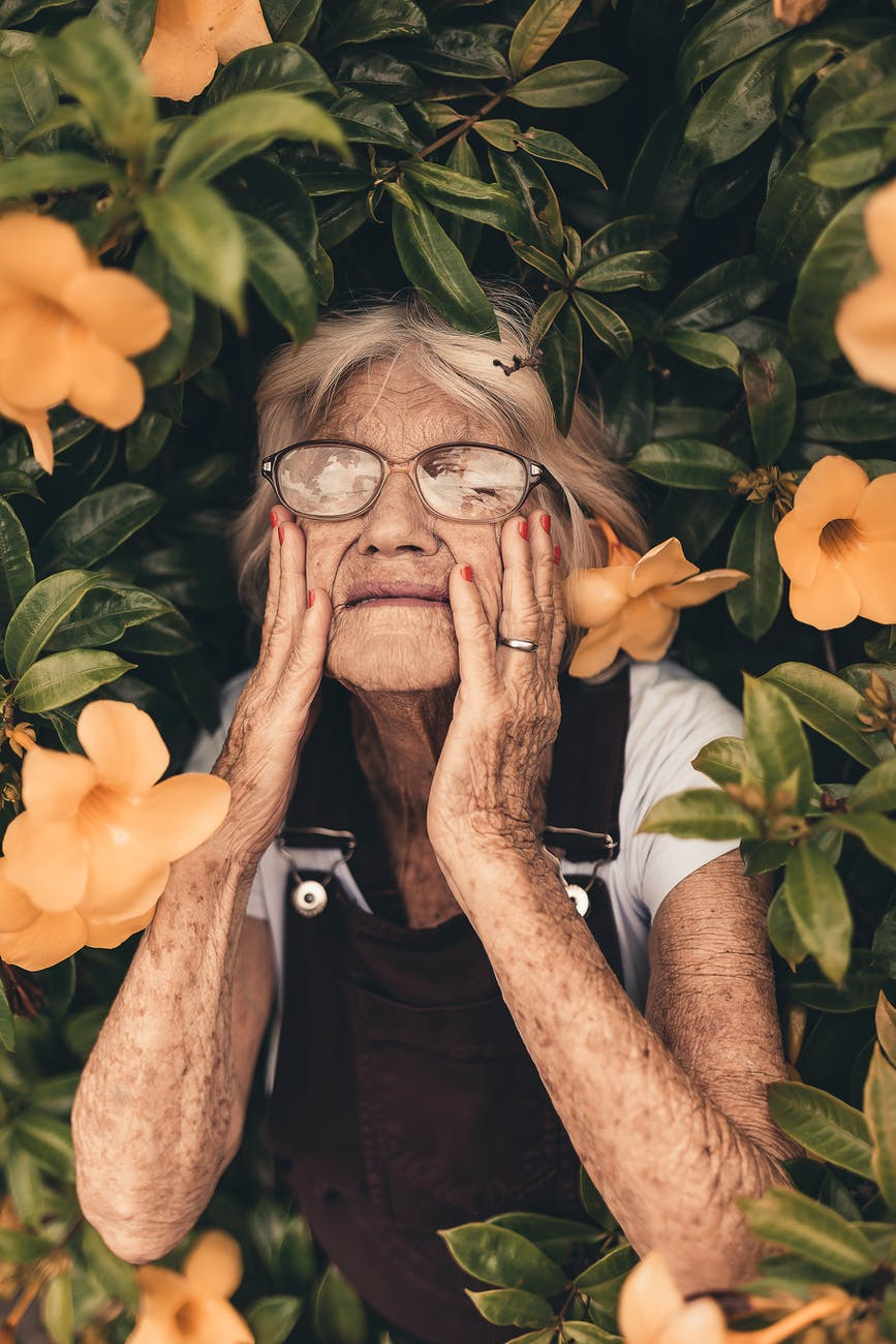 Old Woman Touching Her Face
