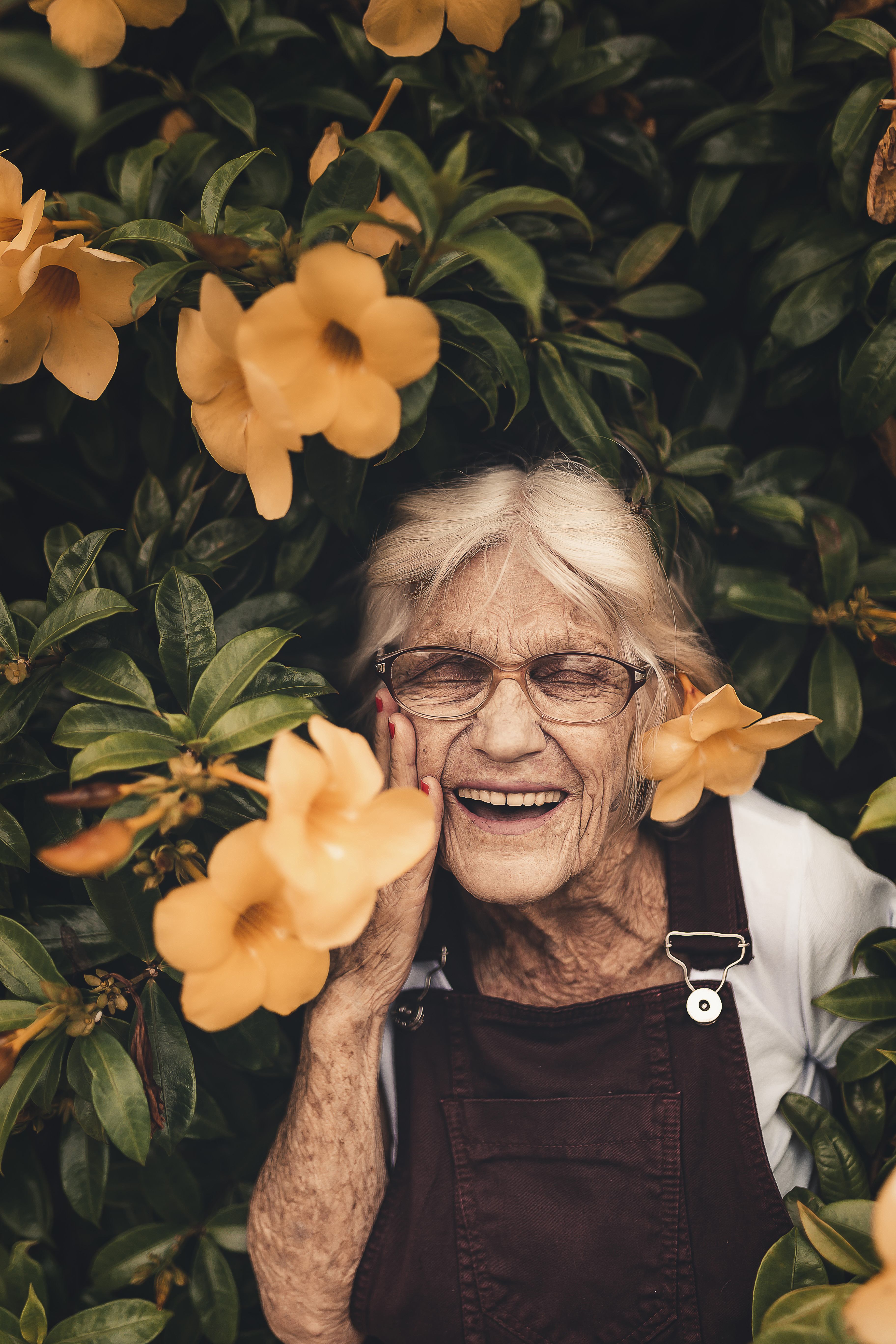 Woman Standing Near Yellow-petaled Flower