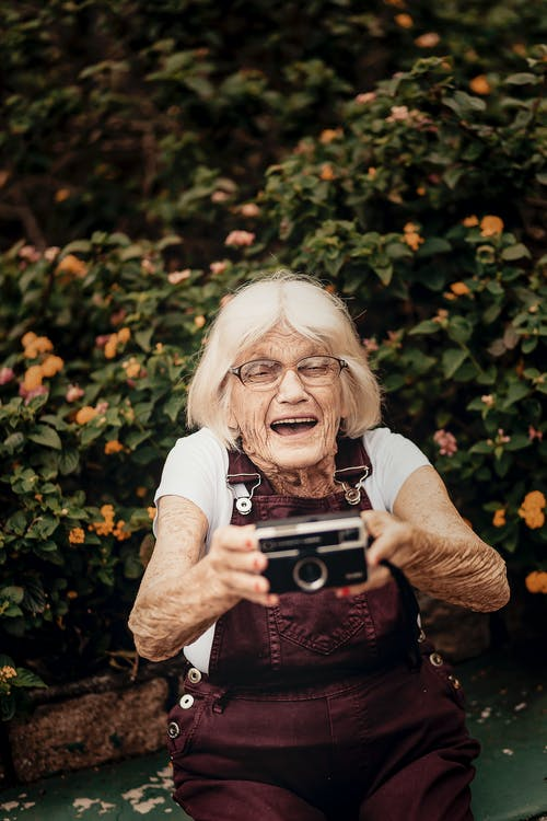 Smiling Woman While Holding Camera