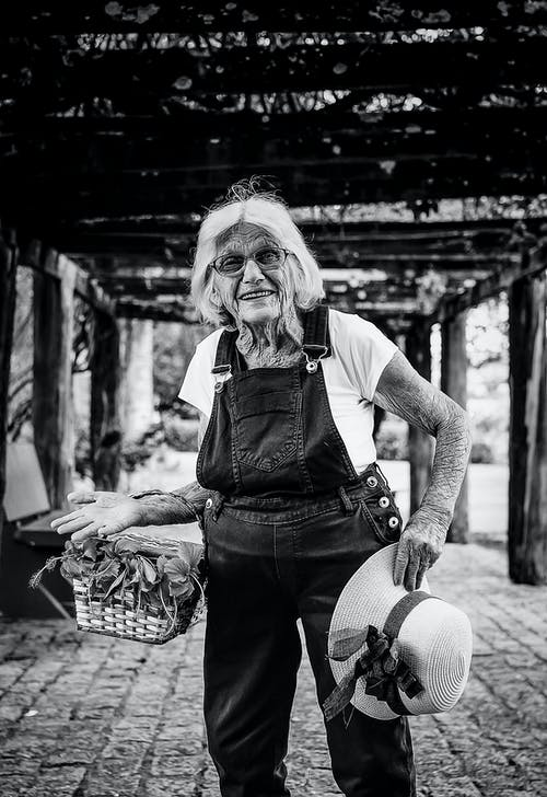 Black And White Photo Of An Elderly Woman