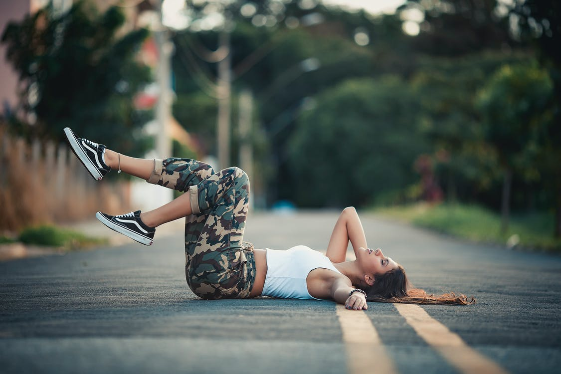 Woman Lying on Street