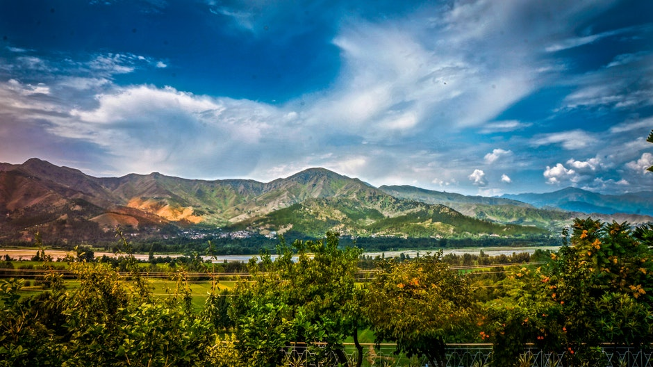 Nature Photography of Mountains and Trees Under Cloudy Sky during Daytime