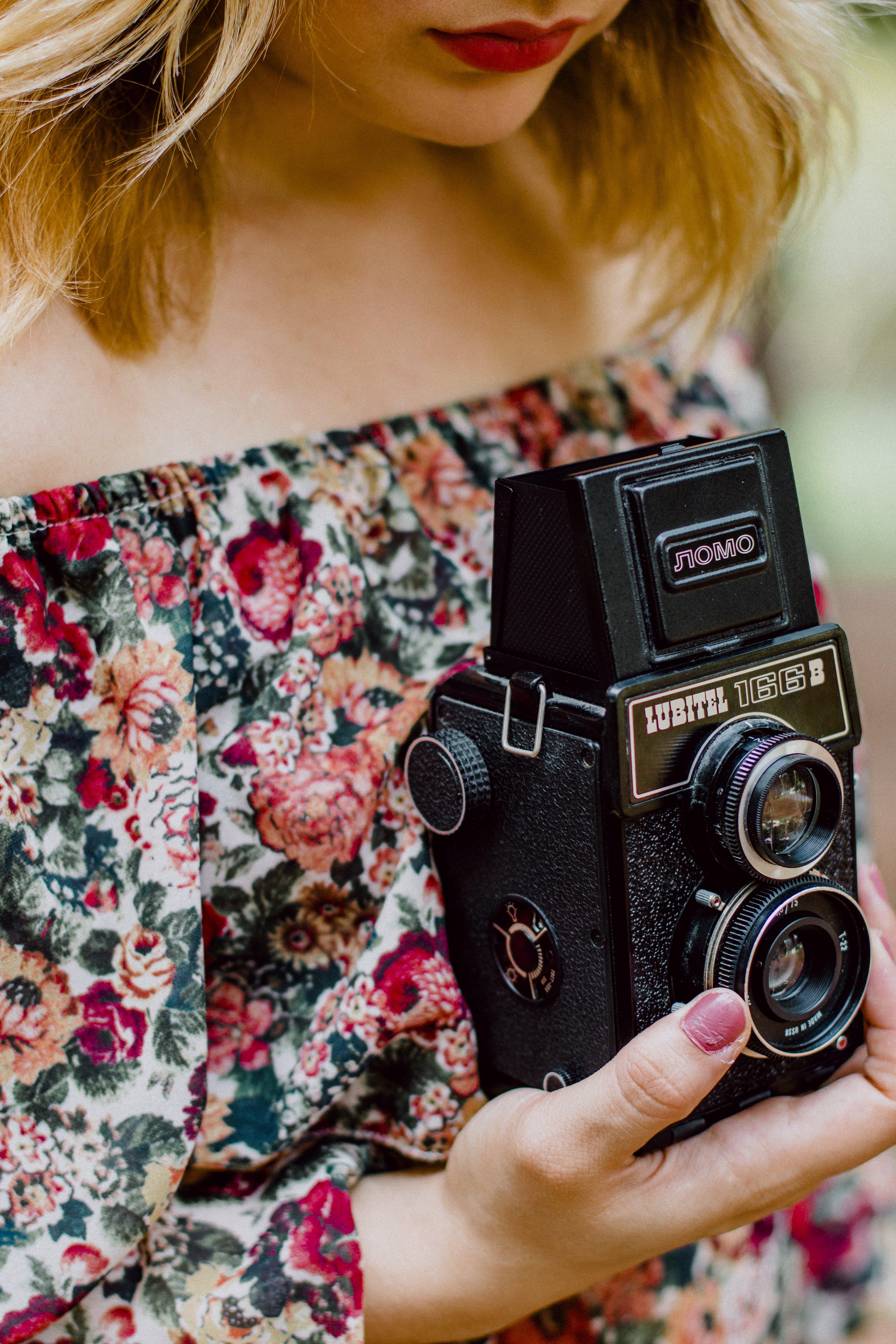 Woman Holding Black Nomo Vintage Camera
