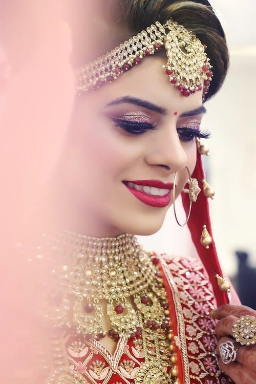 Smiling Woman Wearing Red and Gray Wedding Sari Dress