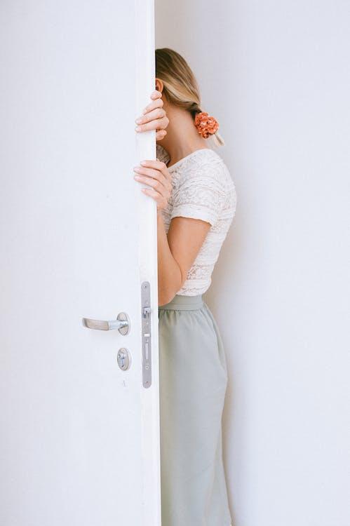 Woman Standing Beside Open Door