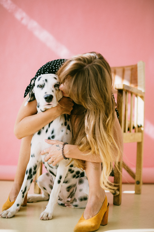 Woman Hugging Dalmatian Dog