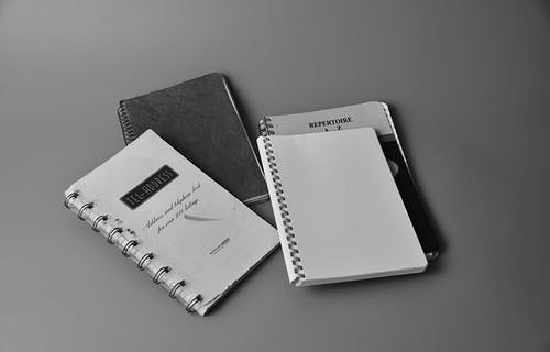 White Notebook on White and Black Book