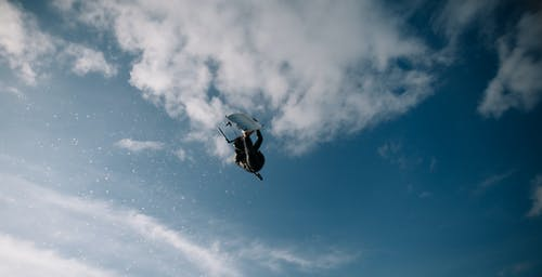 Low Angle Photo of Wakeboarder in the Sky