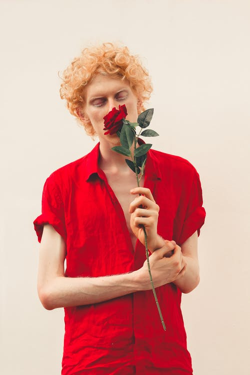 Photo of Man Holding Red Rose