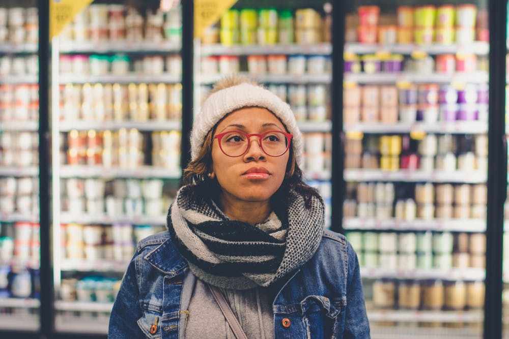 Woman wearing blue denim jacket in the supermarket. | Photo: Pexels