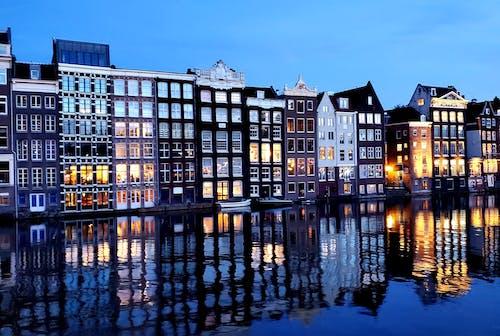 Photos gratuites de appartements, architecture, bâtiments, bord de l'eau