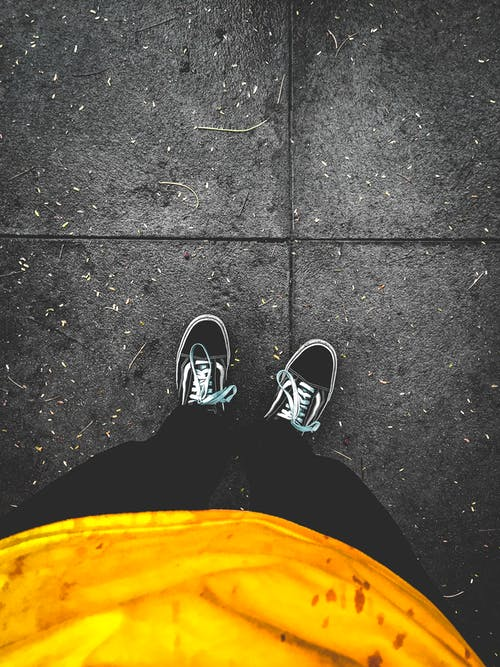 Photo of Person Wearing Sneakers