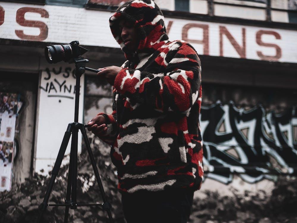 Man Standing Holding Camera