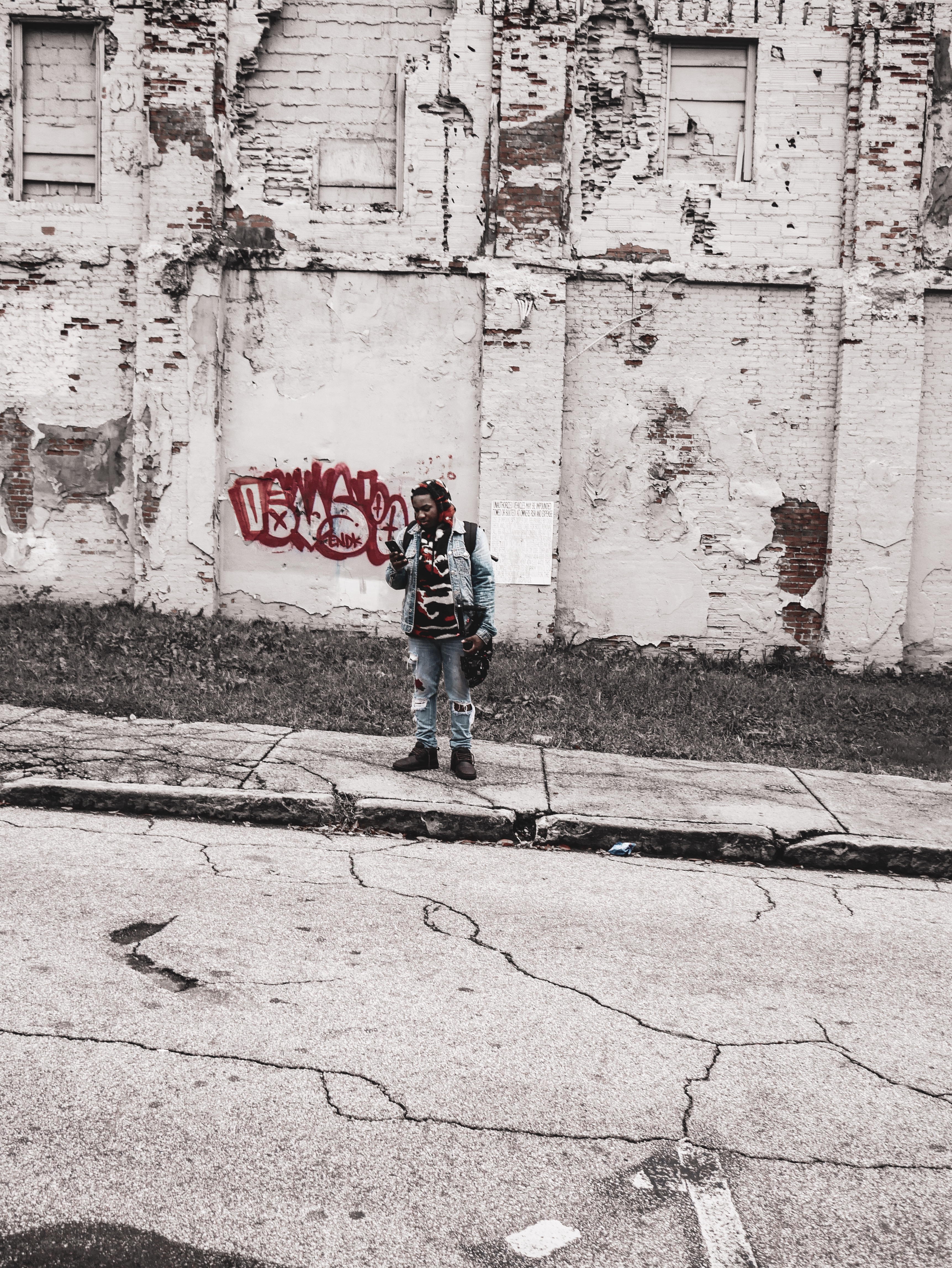 Man Standing in Front of Red Graffiti