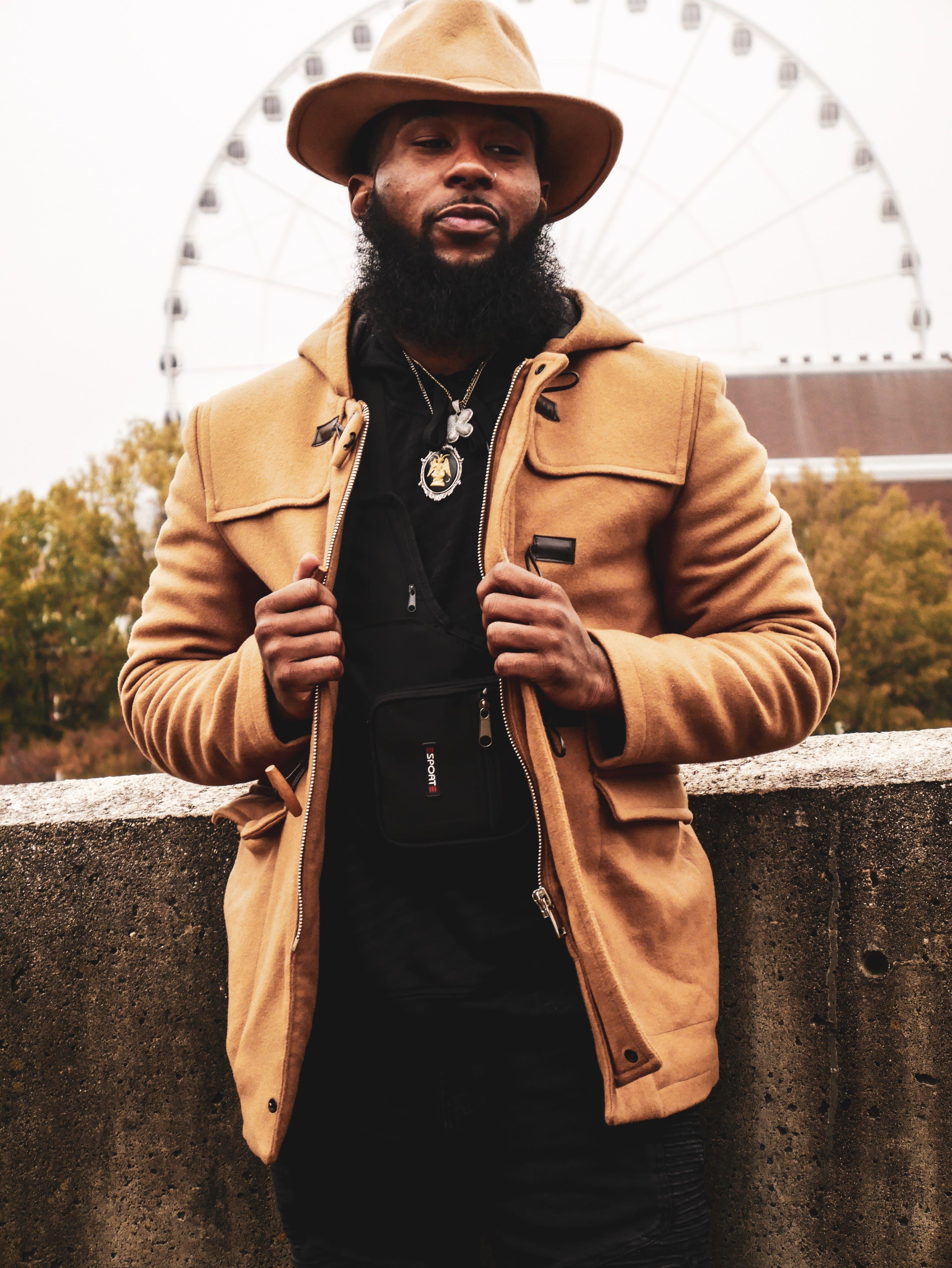 Man Wearing Brown Zip-up Hoodie