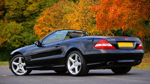 Black Mercedes Benz Convertible on Gray Concrete Floor