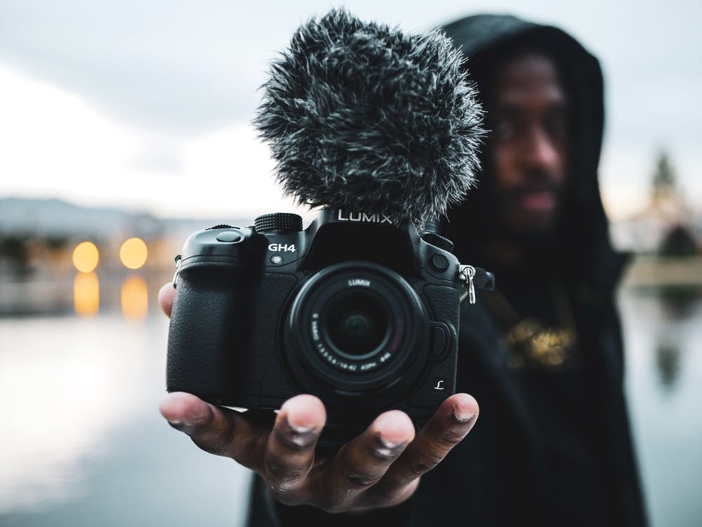 Man Holding Lumix Digital Camera