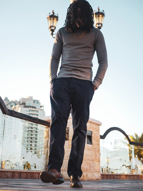 Man in Grey Long-sleeved Shirt and Black Jeans