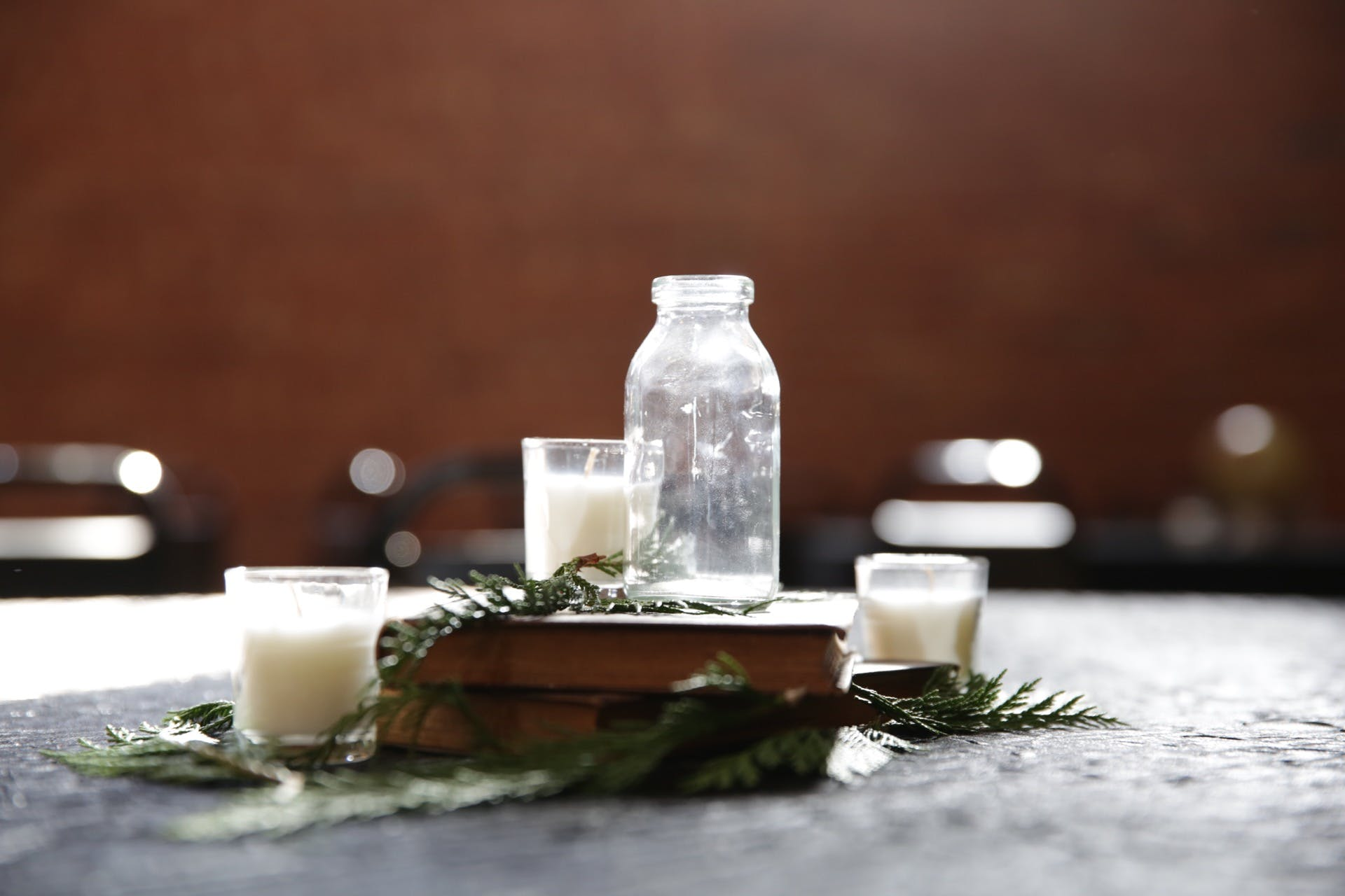 Clear Glass Bottle Beside Candle Holder