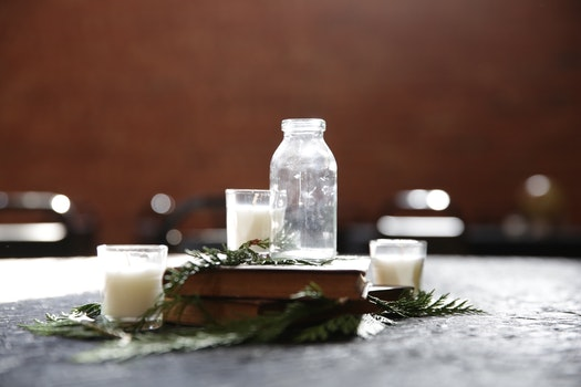 Free stock photo of glass, table, candles, bottle